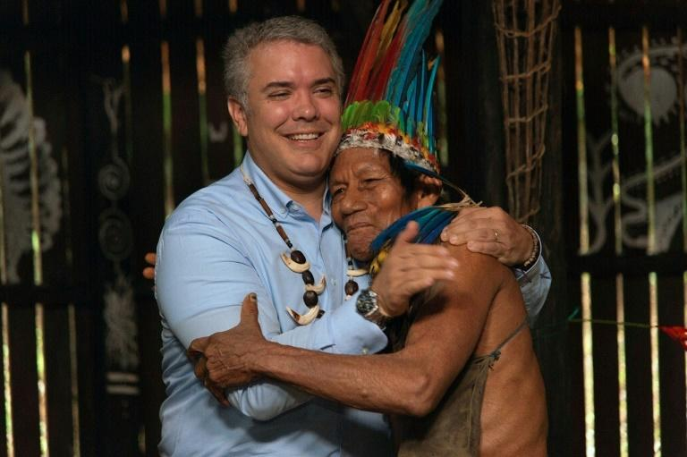Colombia's President Ivan Duque embracing an indigenous leader before the meeting in Leticia