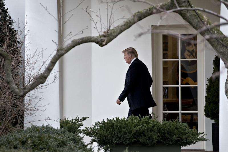 President Donald Trump walks out of the Oval Office on Feb. 16.  (Bloomberg via Getty Images)