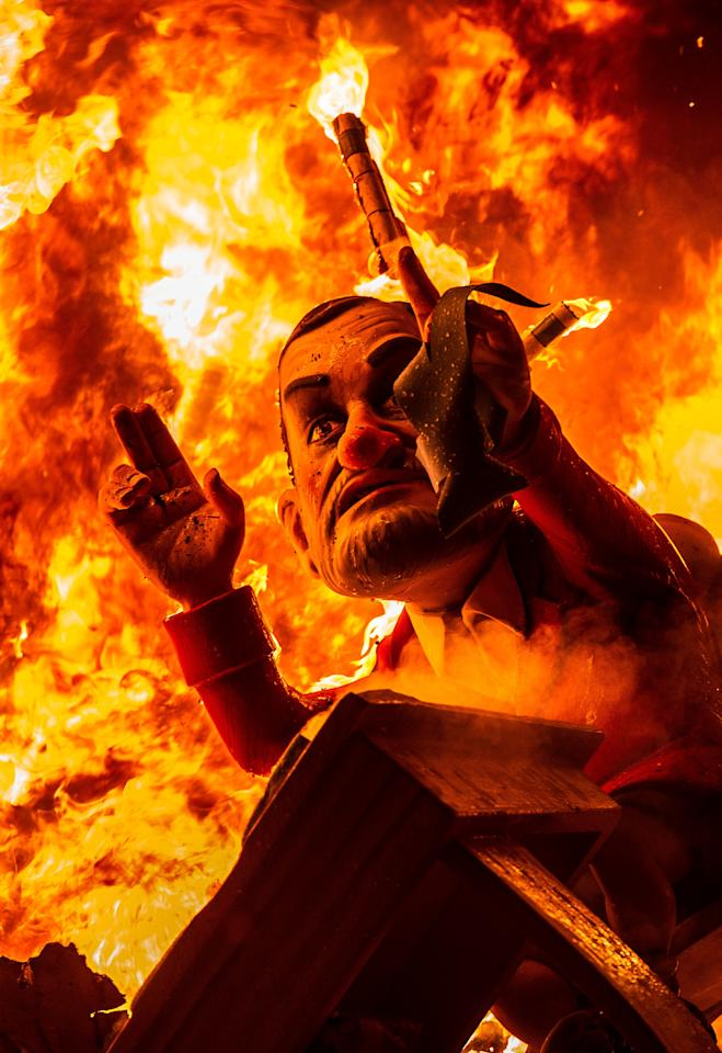 VALENCIA, SPAIN - MARCH 20:  A 'Ninot' (puppet) depicting Spanish Prime Minister Mariano Rajoy burns during the last day of the Las Fallas Festival on March 20, 2013 in Valencia, Spain. The Fallas festival, which runs from March 15 until March 19, celebrates the arrival of spring with fireworks, fiestas and bonfires made by large puppets named Ninots.  (Photo by David Ramos/Getty Images)