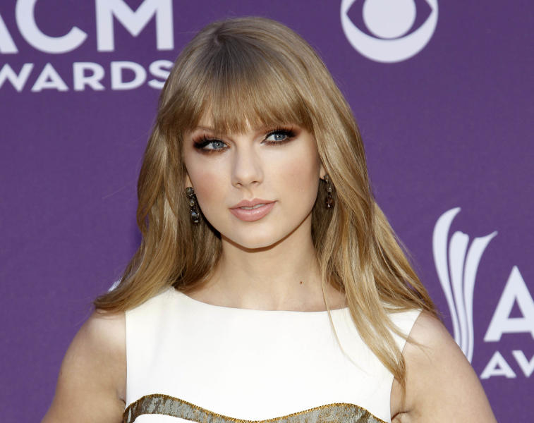 "FILE - This April 1, 2012 file photo shows country singer Taylor Swift at the 47th Annual Academy of Country Music Awards in Las Vegas. Swift's ""The Hunger Games"" soundtrack entry ""Safe & Sound"" with The Civil Wars _ a duo happily adopted by Swift's fan base _ also is nominated for video of the year for the 2012 CMT Awards, which kicks off at 8 p.m. EDT Wednesday, June 6, from Nashville's Bridgestone Arena.. (AP Photo/Isaac Brekken)"