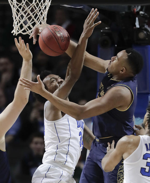 Duke forward Wendell Carter Jr (34) and Notre Dame forward Bonzie Colson (35) battle for a rebound during the first half of an NCAA college basketball game in the Atlantic Coast Conference men's tournament Thursday, March 8, 2018, in New York. (AP Photo/Julie Jacobson)