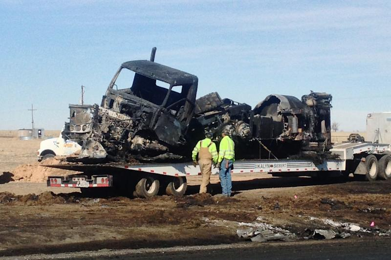 This photo, courtesy of KFDA NewsChannel 10 Amarillo shows the charred remains Monday, March 11, 2013, after a fatal wreck Sunday between   a tanker loaded with fuel and a car with five teens near Dumas, Texas. The deaths of the five Texas teens came the same day as an accident in Ohio that killed six and a day before a crash in Illinois killed four. Three teenagers died Friday in Indiana when police said the drivers of two pickups ran a four-way stop and collided. (AP Photo/KFDA NewsChannel 10 Amarillo)