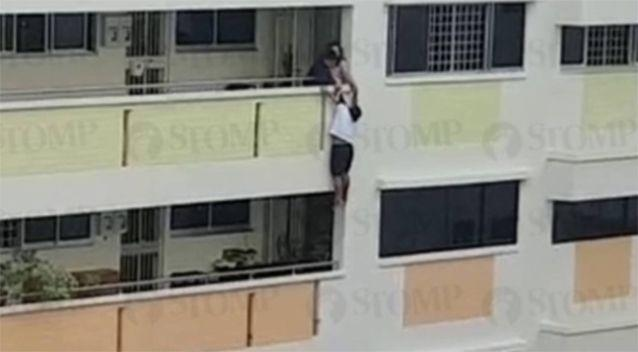 The woman was seen dangling from the balcony. Source: STOMP