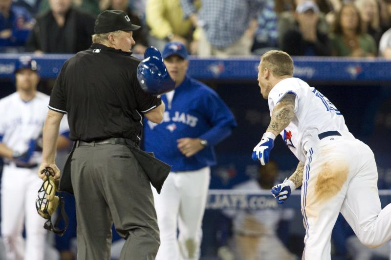 Home Plate umpire Bill Miller, left, is struck by Toronto Blue Jays third baseman Brett Lawrie's helmet as he contests a strike out call during the ninth inning of a baseball game against Tampa Bay Rays in Toronto on Tuesday May 15 , 2012. (AP Photo/The Canadian Press, Chris Young)