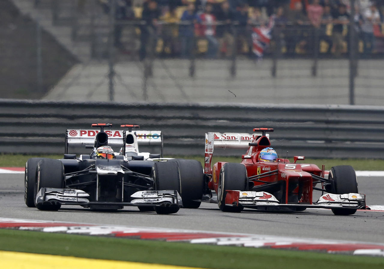SHANGHAI, CHINA - APRIL 15: Williams-Renault driver Bruno Senna (L) of Brazil and Fernando Alonso of Spain and Ferrari drive during the Chinese Formula One Grand Prix at Shanghai International Circuit on April 15, 2012 in Shanghai, China.  (Photo by Gu Zhichao/Sports Illustrated China/Getty Images)