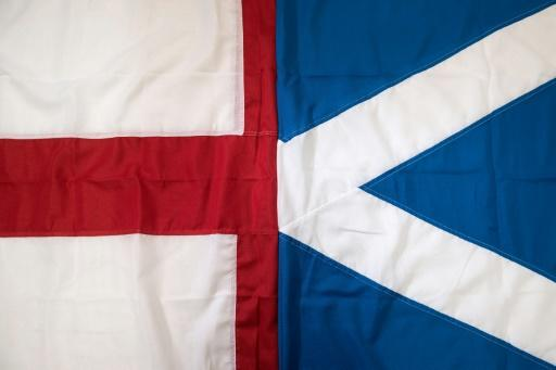 England's St George's Cross flag (left) and Scotland's Saltire