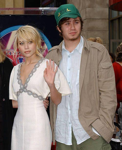 <p>Older brother Trent has appeared in a few of the twin's videos, but he prefers to keep a low profile and private life. Here, he's shown with Ashley at a Hollywood event. </p>