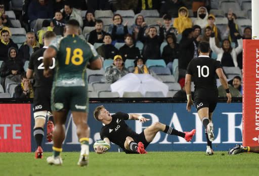 New Zealand's Jordie Barrett celebrates after scoring a try during the Bledisloe rugby test between the All Blacks and the Wallabies at Stadium Australia, Sydney, Australia, Saturday, Oct. 31, 2020. (AP Photo/Rick Rycroft)