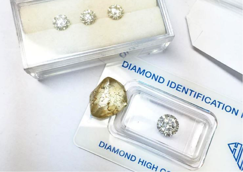 The rough, polished, and graded diamond.