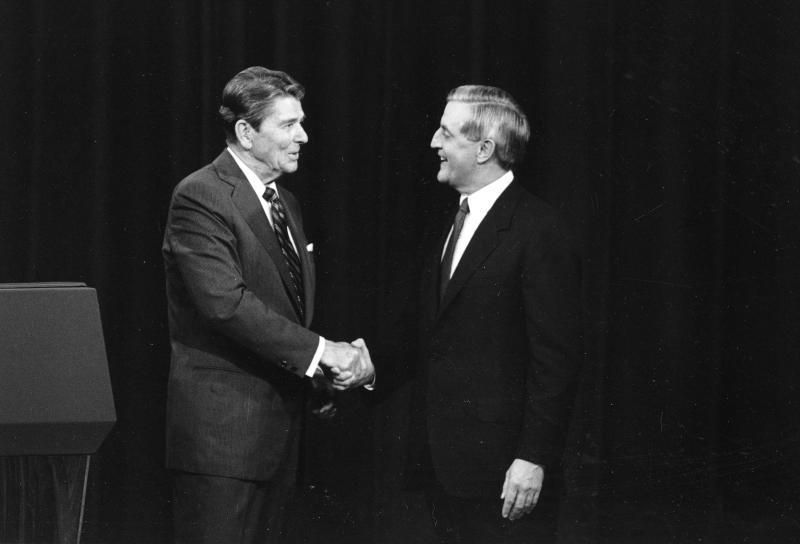 FILE - In this Oct. 22, 1984, file photo, President Ronald Reagan, left, and his Democratic challenger Walter Mondale, shake hands prior to their televised presidential debate, in Kansas City, Mo. When Reagan won the White House in 1980, he was 69 _ the oldest man ever elected to the office. During his successful 1984 re-election campaign, he faced questions about his age in his head-to-head contest with 56-year-old Walter Mondale, the former vice president. They spend hours mastering policy. Learning to lean on the podium just so. Perfecting the best way to label their opponents as liars without whining. But presidential candidates and their running mates often find that campaign debates turn on unplanned zingers, gaffes or gestures that speak volumes. Debate wins and losses often are scored based on the overall impressions that candidates leave with voters. In the history books, though, small debate moments often end up telling the broader story. (AP Photo/Ron Edmonds, File)
