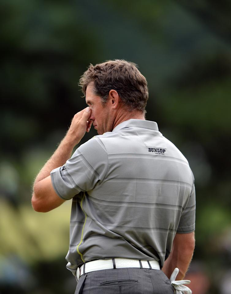 ARDMORE, PA - JUNE 14: Lee Westwood of England reacts on the tenth green after completing Round Two of the 113th U.S. Open at Merion Golf Club on June 14, 2013 in Ardmore, Pennsylvania. (Photo by Ross Kinnaird/Getty Images)