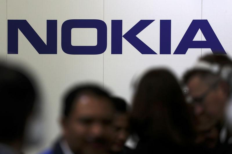 Visitors gather outside the Nokia booth at the Mobile World Congress in Barcelona