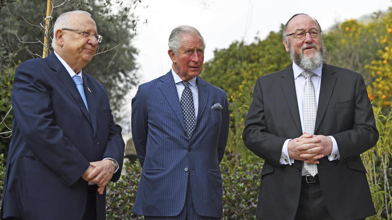 Britain's Prince Charles, center, meets with Israel President Reuven Rivlin, left, and Chief Rabbi Ephraim Mirvis at his official residence in Jerusalem, Thursday Jan. 23, 2020. Prince Charles is among dozens of presidents, heads of state and dignitaries who have descended upon the city to attend the largest-ever gathering focused on commemorating the Holocaust and combating modern-day anti-Semitism (Victoria Jones/Pool via AP)
