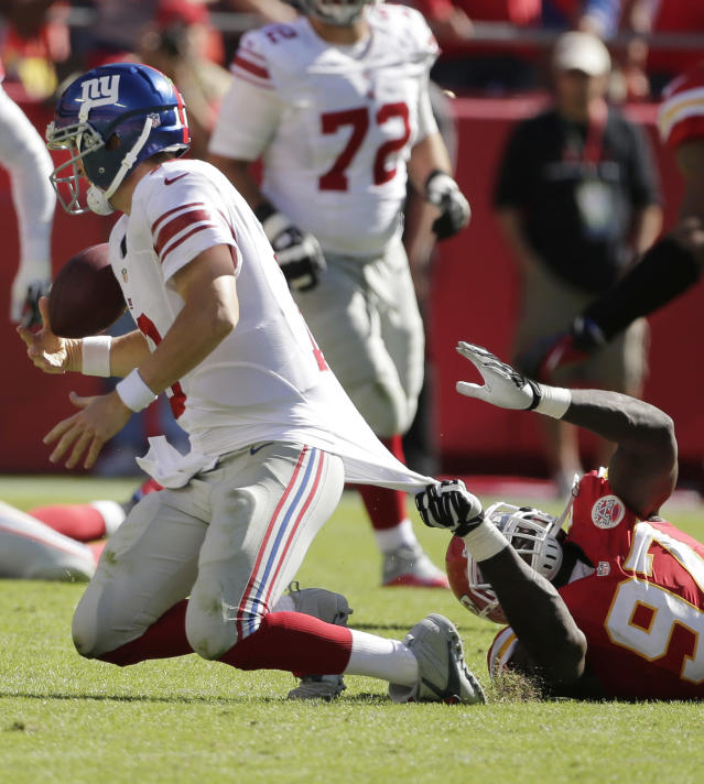 New York Giants quarterback Eli Manning (10) is tackled by Kansas City Chiefs defensive end Allen Bailey (97) during the second half of an NFL football game at Arrowhead Stadium in Kansas City, Mo., Sunday, Sept. 29, 2013. The Chiefs defeated the Giants 31-7. (AP Photo/Charlie Riedel)