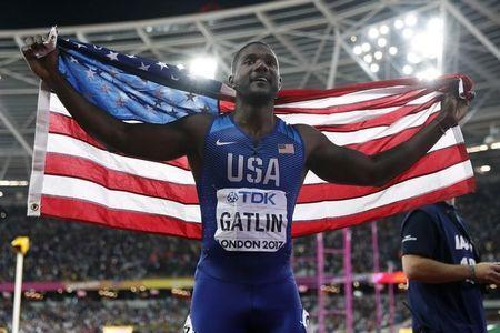 FILE PHOTO - Athletics - World Athletics Championships - Men's 100 Metres Final - London Stadium, London, Britain – August 5, 2017. Justin Gatlin of the U.S. celebrates after winning the final. REUTERS/Matthew Childs