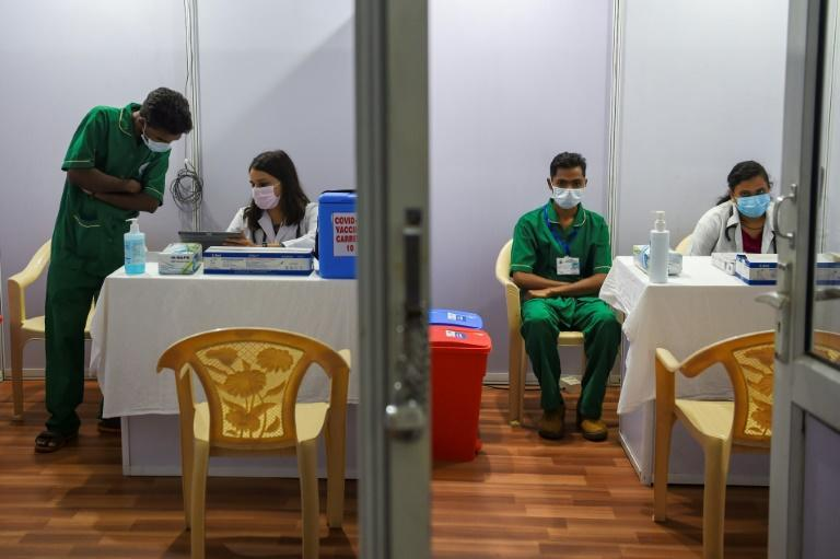 Medical staff work inside a Covid-19 vaccination centre in Mumbai on January 15, 2021 amid concern a new virus wave might hit, fuelled by a string of recent mass religious festivals