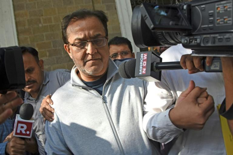 Rana Kapoor, the founder of India's Yes Bank, is pictured after his arrest in Mumbai (AFP Photo/Bhushan KOYANDE)