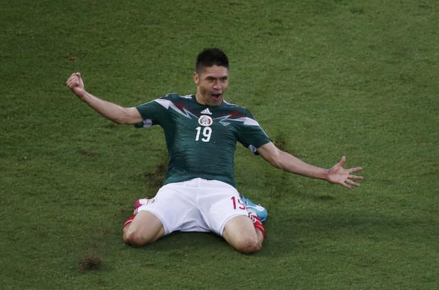 Mexico's Oribe Peralta celebrates after scoring a goal during their 2014 World Cup Group A match against Cameroon at Dunas arena in Natal June 13, 2014. REUTERS/Carlos Barria (BRAZIL - Tags: SOCCER SPORT WORLD CUP)