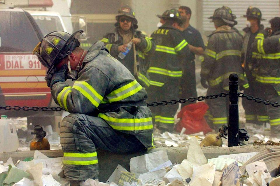<p>A firefighter breaks down in the wreckage of the World Trade Center following a terrorist attack.</p>