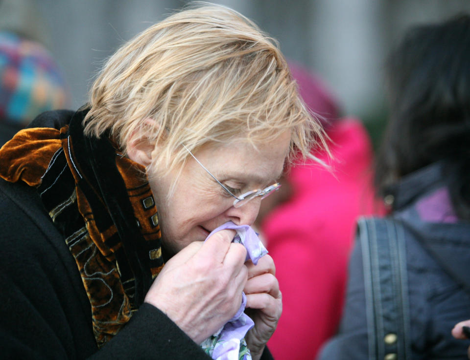 A Madoff victim waits in line to go in to the Manhattan federal courthouse in New York, March 12, 2009. (PHOTO: REUTERS/Brendan McDermid)