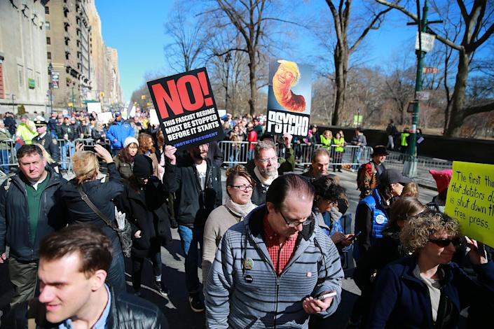 """<p>Thousands of people sing and hoeld up signs at the """"Not My President's Day"""" rally on Central Park West in New York City on Feb. 20, 2017. (Gordon Donovan/Yahoo News) </p>"""