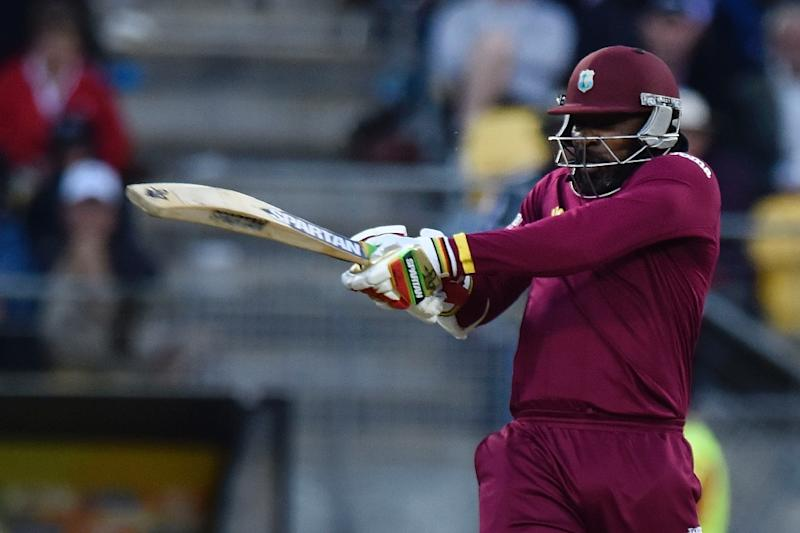 West Indies' batsman Chris Gayle plays a shot during the Cricket World Cup Quarter Final match between New Zealand and the West Indies at Wellington Regional Stadium in Wellington on March 21, 2015