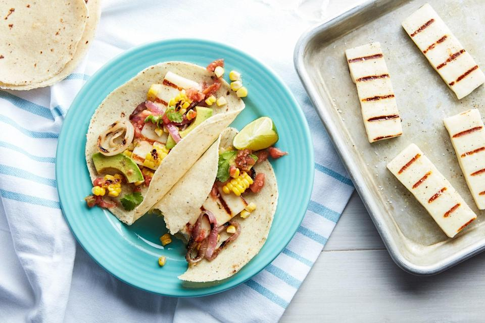 """Salty, smoky grilled Halloumi is the star of this tasty, satisfying vegetarian option for the grill. <a href=""""https://www.epicurious.com/recipes/food/views/grilled-cheese-tacos?mbid=synd_yahoo_rss"""" rel=""""nofollow noopener"""" target=""""_blank"""" data-ylk=""""slk:See recipe."""" class=""""link rapid-noclick-resp"""">See recipe.</a>"""