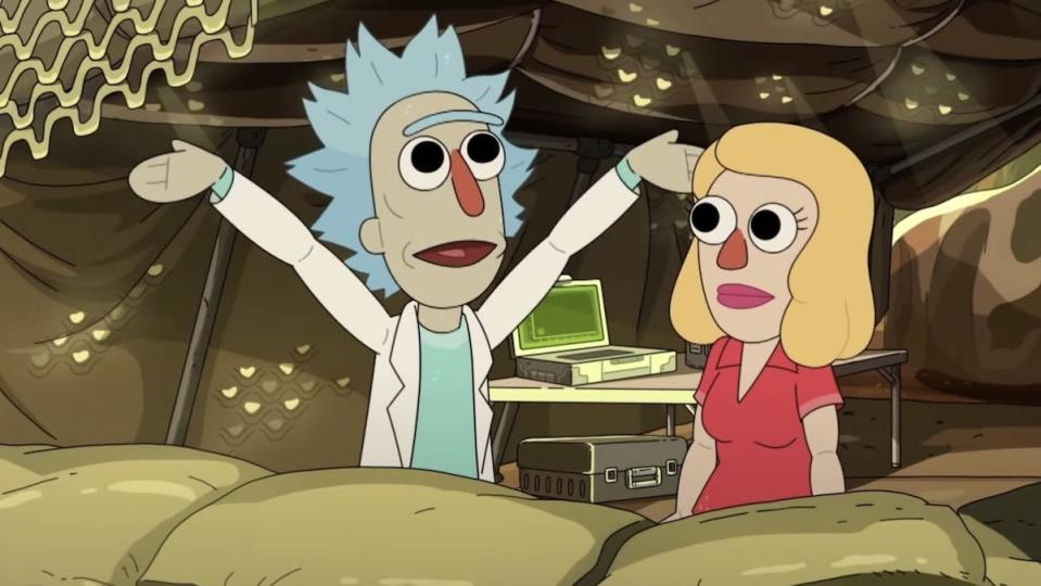 A doll version of Rick throws his arms out wide talking to a doll Beth inside a army tent