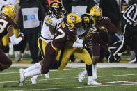 Minnesota defensive back Tyler Nubin (27) tackles Iowa running back Tyler Goodson during the first half of an NCAA college football game Friday, Nov. 13, 2020, in Minneapolis. (AP Photo/Stacy Bengs)
