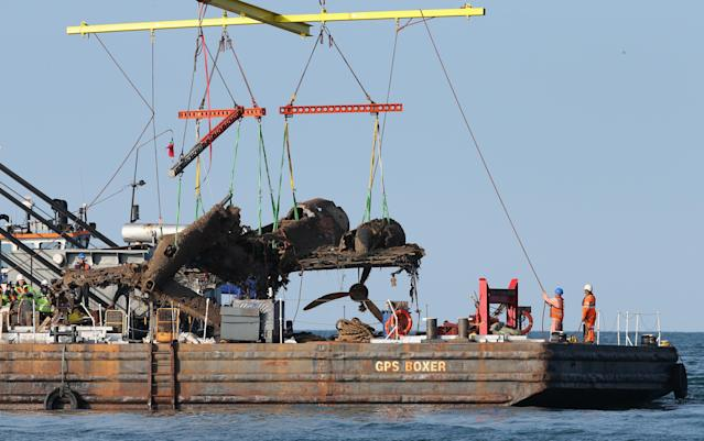 RAMSGATE, ENGLAND - JUNE 10: Workers hang onto the ropes helping a World War II Dornier 17 aircraft being lifted from waters of the English Channel on June 10, 2013 near Ramsgate, England. The salvage is planned through the RAF Museum to lift the only remaining German bomber Dornier 17, used during the 'Battle of Britain' of 1940. The plane on the Goodwin Sands is believed to be aircraft call-sign 5K-AR, shot down on August 26, 1940 at the height of the battle by RAF Boulton-Paul Defiant fighters. The Project has suffered many delays due to poor weather. Once recovered, the aircraft will be preserved and put on displayed for the public at the museum's Hendon base in north London. (Photo by Peter Macdiarmid/Getty Images)