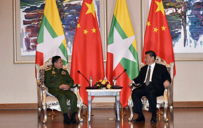 In this photo released by Office of the Commander in Chief of Defense Services, Myanmar's Army Commander Senior Gen. Min Aung Hlaing, left, speaks with Chinese President Xi Jinping at a hotel in Naypyitaw, Myanmar, Saturday, Jan. 18, 2020. (Office of the Commander in Chief of Defense Services via AP)