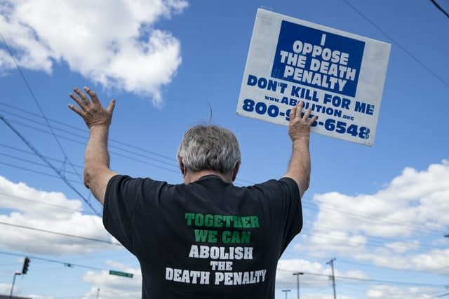 Protesters against the death penalty gather in Terre Haute (Michael Conroy/AP)