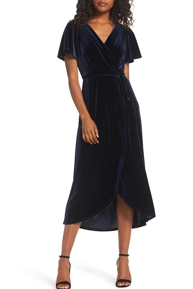 "<p><strong>BUY IT: $129; </strong><a href=""https://click.linksynergy.com/deeplink?id=93xLBvPhAeE&mid=1237&murl=https%3A%2F%2Fshop.nordstrom.com%2Fs%2Fchelsea28-velvet-faux-wrap-midi-dress%2F4617726%3Forigin%3Dcategory-personalizedsort%26breadcrumb%3DHome%252FWomen%252FClothing%252FDresses%26fashioncolor%3DBlue%26color%3Dnavy%2520blazer&u1=SL%2CRX_1910_NavyBlueHolidayDresses_VelvetFauxWrapMidiDress%2Cjmcdonald0953%2C%2CIMA%2C648002%2C201910%2CI"" target=""_blank"">nordstrom.com</a></p>"