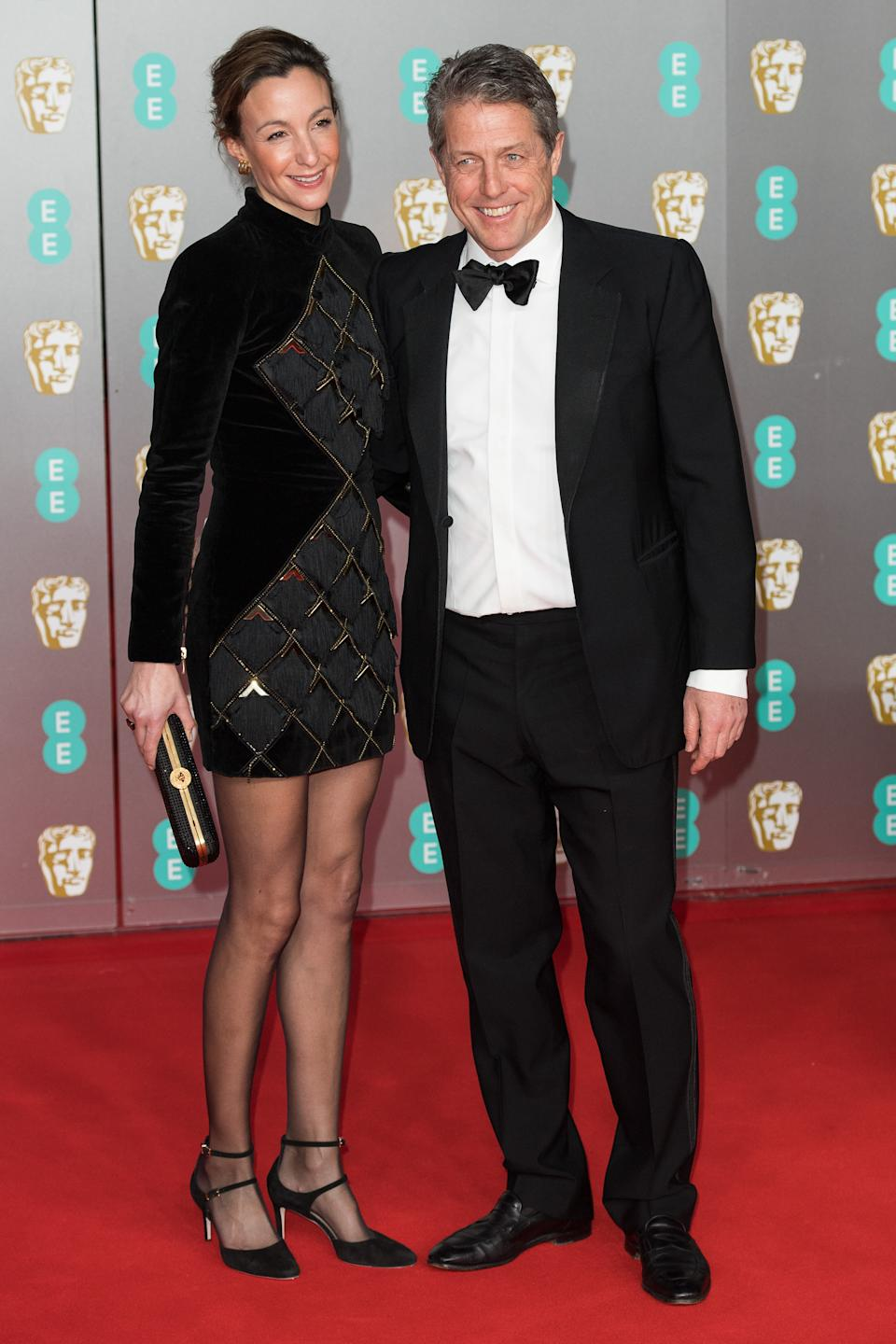 Anna Elisabet Eberstein and Hugh Grant attend the EE British Academy Film Awards 2020 at Royal Albert Hall on February 02, 2020 in London, England. (Photo by Jeff Spicer/Getty Images)