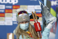 United States' Jessie Diggins poses after winning the women's cross-country Tour de Ski, in Val di Fiemme, Italy, Sunday, Jan. 10, 2021. (AP Photo/Alessandro Trovati)