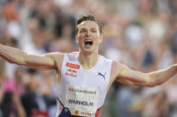 Norway's Karsten Warholm celebrates after running 46.70 seconds to set a new men's 400m hurdles world record at the Diamond League meeting in Oslo, Norway Thursday July 1, 2021. (Fredrik Hagen, NTB via AP)