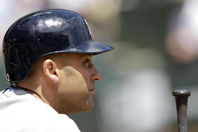 New York Yankees' Derek Jeter looks to the field during the first inning of a baseball game against the Chicago White Sox in Chicago on Saturday, May 24, 2014. (AP Photo/Nam Y. Huh)