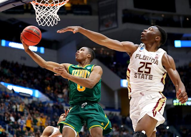 <p>Stef Smith #0 of the Vermont Catamounts goes up for a shot in front of Mfiondu Kabengele #25 of the Florida State Seminoles during their first round game of the 2019 NCAA Men's Basketball Tournament at XL Center on March 21, 2019 in Hartford, Connecticut. (Photo by Maddie Meyer/Getty Images) </p>