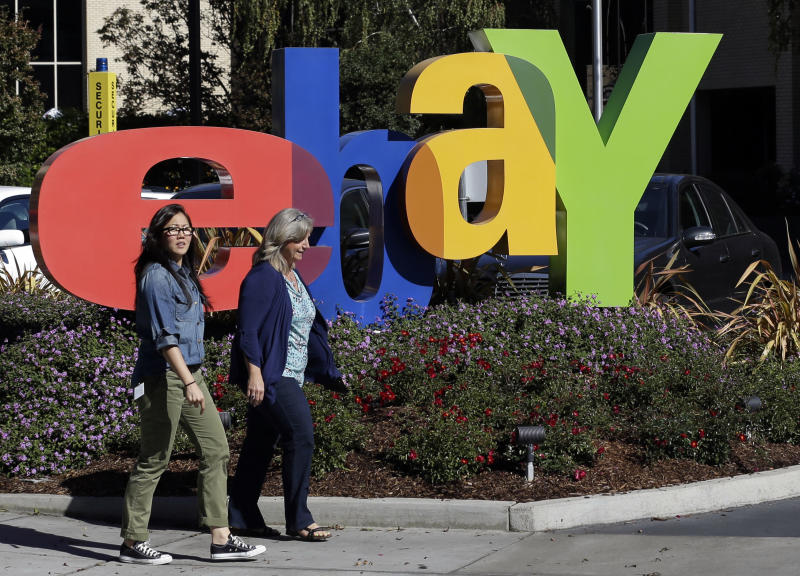 Two women walk in front of a eBay sign at the company's headquarters in San Jose, Calif., Wednesday, Oct.17, 2012. EBay says its third-quarter net income grew 22 percent, helped by higher revenue at its PayPal payments service and the marketplaces business that includes eBay.com. (AP Photo/Marcio Jose Sanchez)