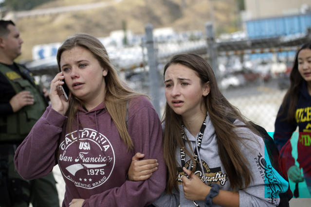 Students are escorted outside of Saugus High School after reports of a shooting on Nov. 14, 2019, in Santa Clarita, Calif. Los Angeles County Sheriff Alex Villanueva tweeted that the suspect was in custody and was being treated at a hospital. He said the suspect was a student but gave no further information. (Photo: Marcio Jose Sanchez/AP)