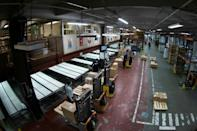 A French warehouse on the outskirts of Paris takes delivery of doses of the Pfizer/BioNTech vaccine