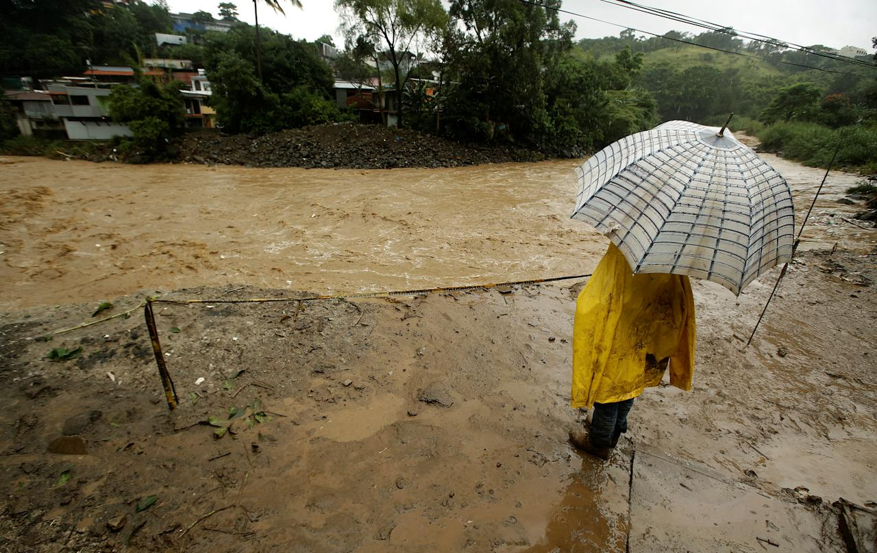 <p>A men stands near Tiribi river, flooded by heavy rains from Tropical Storm Nate in San Jose, Costa Rica, Oct. 5, 2017. (Photo: Juan Carlos Ulate/Reuters) </p>