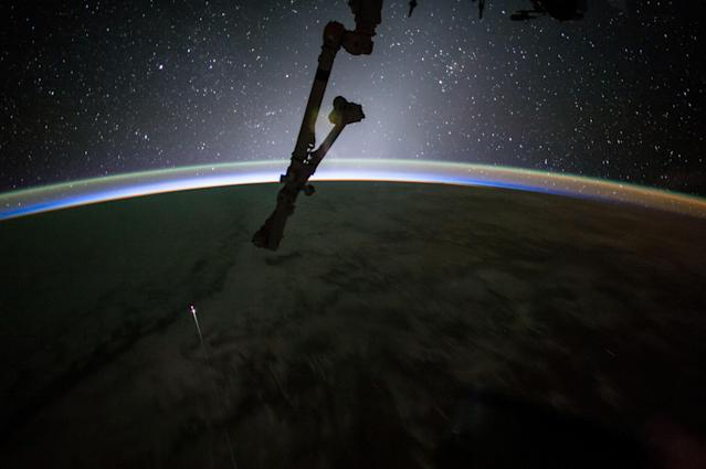 <p>The SpaceX Dragon capsule reentered Earth's atmosphere before splashing down in the Pacific Ocean west of Baja California on July 3, 2017. (Photo: NASA/Jack Fischer/Handout via Reuters) </p>