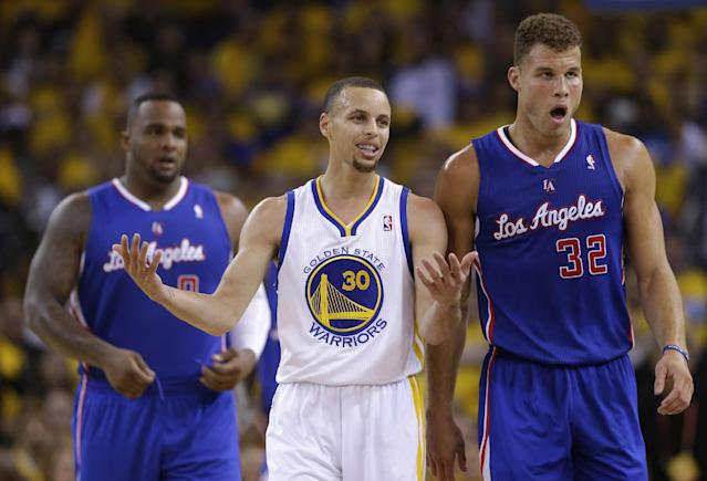 Golden State Warriors' Stephen Curry (30) argues a call next to Los Angeles Clippers' Blake Griffin (32) and Glen Davis, left, during the first half in Game 3 of an opening-round NBA basketball playoff series on Thursday, April 24, 2014, in Oakland, Calif. (AP Photo/Marcio Jose Sanchez)