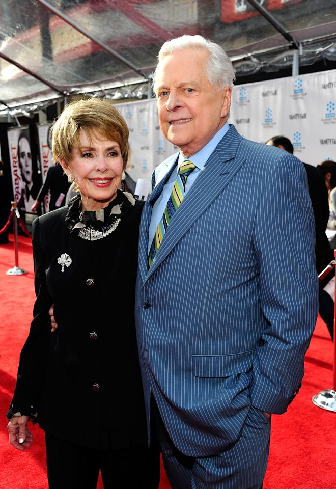 """HOLLYWOOD, CA - APRIL 12:  Actress Barbara Rush (L) and actor/ film historian Robert Osborne arrive at the TCM Classic Film Festival opening night premiere of the 40th anniversary restoration of """"Cabaret"""" at Grauman's Chinese Theatre on April 12, 2012 in Hollywood, California.  (Photo by Alberto E. Rodriguez/Getty Images)"""