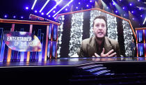 Luke Bryan appears on screen accepting the award for entertainer of the year at the 56th annual Academy of Country Music Awards on Sunday, April 18, 2021, at the Grand Ole Opry in Nashville, Tenn. (AP Photo/Mark Humphrey)