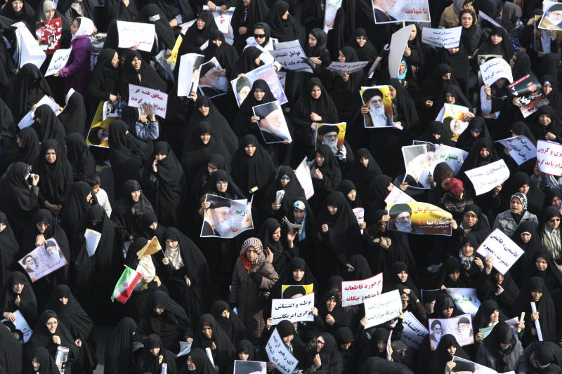 Holding posters of the Iranian supreme leader Ayatollah Ali Khamenei, female worshippers attend a pro-government rally after their Friday prayers in Tehran, Iran, Friday, Feb. 18, 2011. Some thousands of pro-government demonstrators walked through the streets calling for the execution of two opposition leaders, Mir Hossein Mousavi and Mahdi Karroubi, in response to anti-government protests earlier this week. (AP Photo/Vahid Salemi)