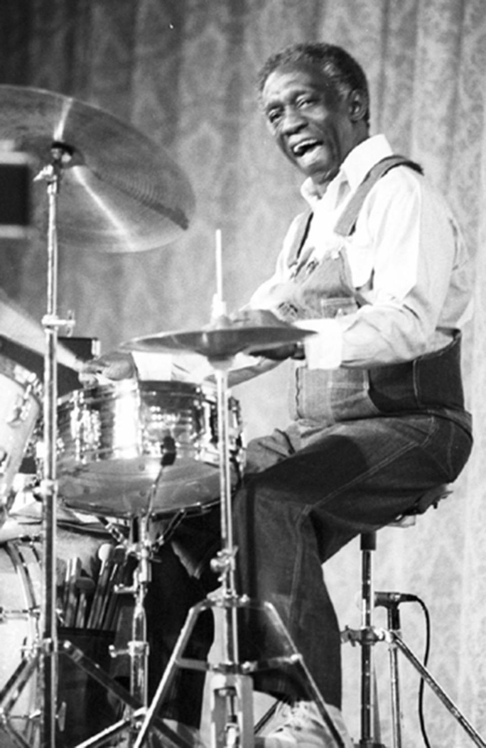 <p>The maestro jazz drummer Art Blakey was known for his aggressive swing style. His hands could move at the speed of light, and he was among one of the most expressive players in the history of jazz drumming. Though Blakey typically performed in a suit, here he's photographed during a rehearsal casually dressed in overalls and sneakers, wearing his other signature: a big, contagious smile. <i>(Photo: Getty Images)</i></p>