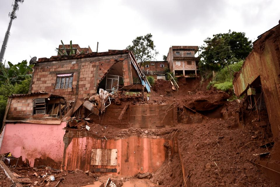 View of damages after a landslide in Vila Bernadete, Belo Horizonte, Minas Gerais state, Brazil, on January 26, 2020. - A landslide buried several houses in Vila Bernadete Friday, leaving 4 dead and 7 missing. Two days of torrential rains in Minas Gerais state have left at least 30 people killed, several injured, 17 missing and more than 2,500 homeless following a series of landslides and house collapses, Civil Defence officials said. (Photo by DOUGLAS MAGNO / AFP) (Photo by DOUGLAS MAGNO/AFP via Getty Images)