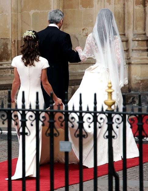 "Before a flawless exchange of vows, a veiled Middleton wearing a laced dress with a long train, the first ""commoner"" to marry a prince in close proximity to the throne in more than 350 years, walked slowly through the 1,900-strong congregation."